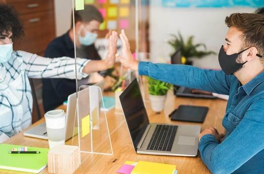 Employee Social Distancing behind Plexiglass
