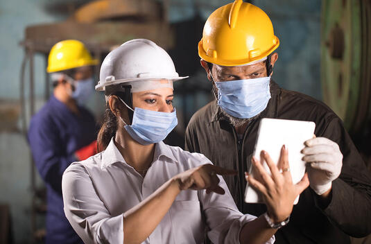 Facility Health Safety Mangers on Tablet
