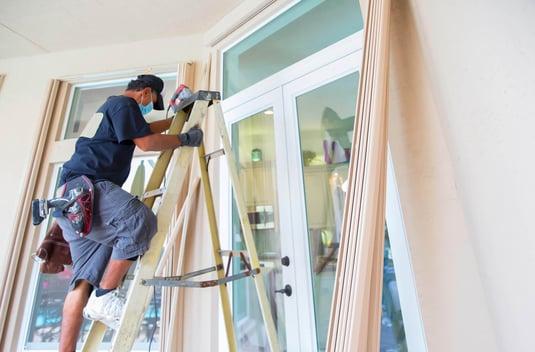 Man Installing Hurricane Shutters