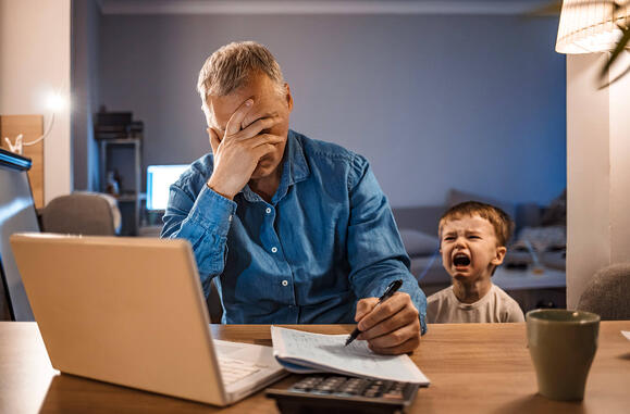 Stressed Employee with Son Working Home
